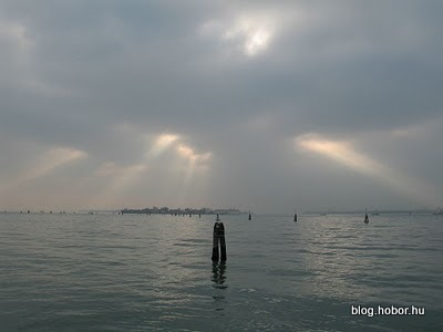 VENICE, Italy - The Sun over the clouds at Lido di Venezia